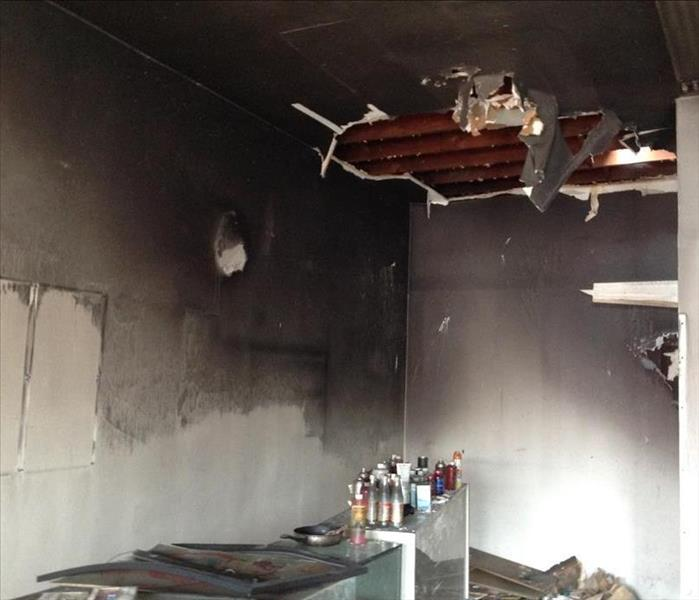 Damaged kitchen after being exposed to fire.