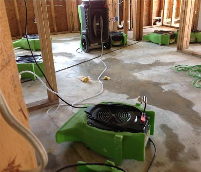 Kitchen area with air scrubbers and dehumidifiers.