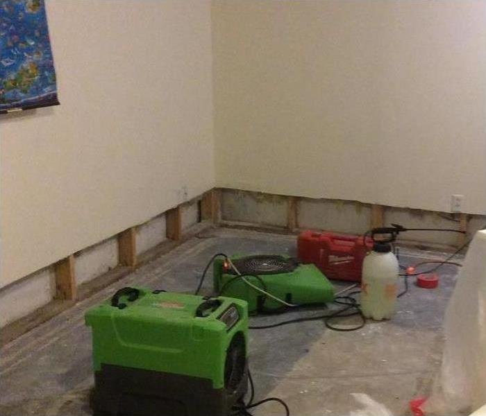 Affected materials removed after flooding in commercial building