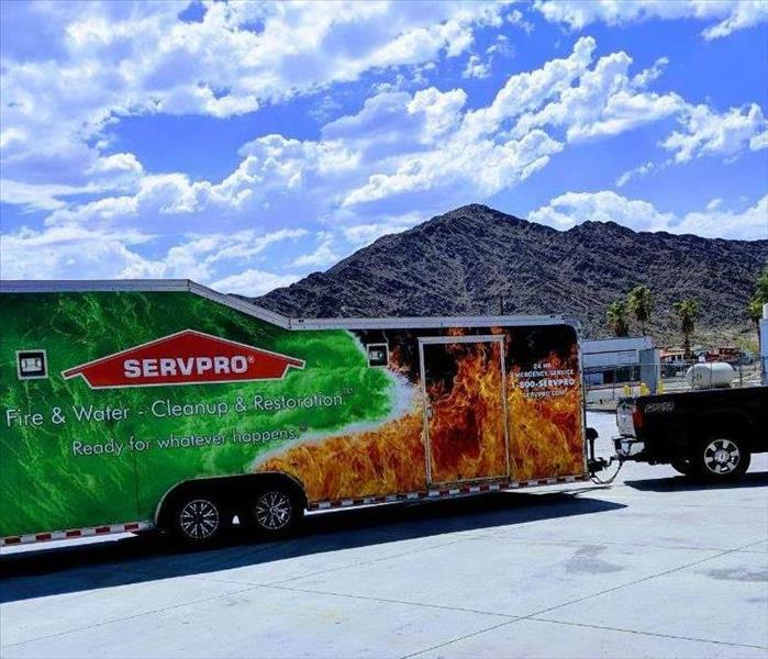 Servpro trailer parked in front of mountains.